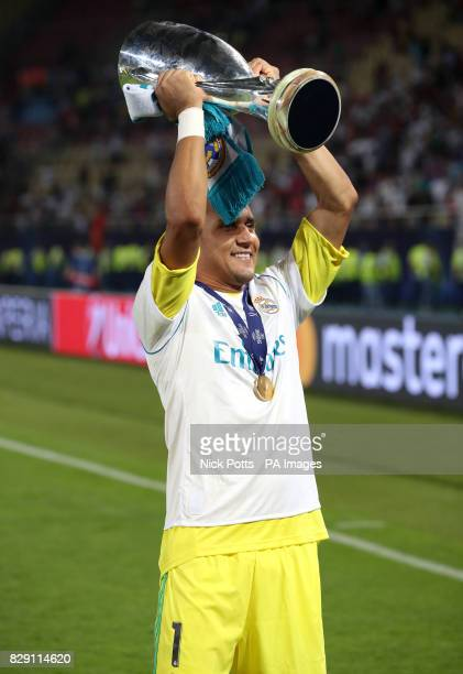 Real Madrid's goalkeeper Keylor Navas celebrates with the UEFA Super Cup Trophy