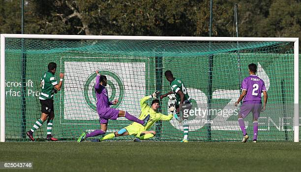 Real Madrid's goalkeeper Luca Zidane saves shot from Sporting CP's midfielder Bubacar Djalo during the UEFA Youth Champions League match between...