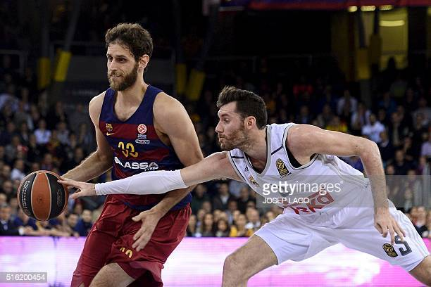 Real Madrid's guard Rudy Fernandez vies with Barcelona's forward Greek Stratos Perperoglou during the Euroleague top 16 group F basketball match FC...