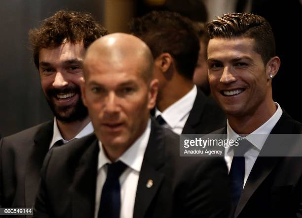 Real Madrid's head coach Zinedine Zidane footballers Sergio Llull and Cristiano Ronaldo attend the announcement of a new sponsorship agreement with...