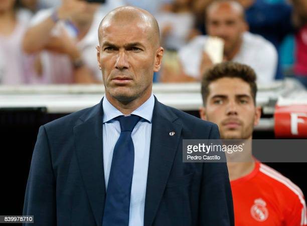 Real Madrid's headcoach Zinedine Zidane and Luca Zidane look on before the La Liga match between Real Madrid and Valencia at Estadio Santiago...