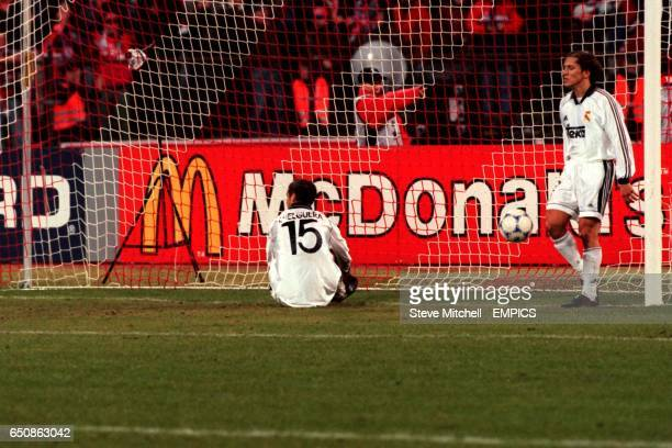 Real Madrid's Helguera and Michel Salgado show their dejection as the ball nestles in the net for Bayern Munich's fourth goal