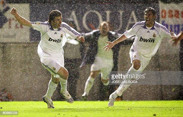 Real Madrid's Higuain and Miguel Torres after winning the Spanish League final match against Osasuna at the Reyno de Navarra stadium in Pamplona on...