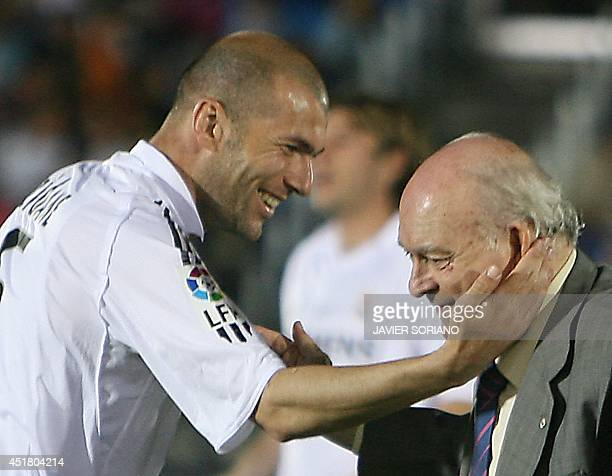 Real Madrid's Honorary President Alfredo Di Stefano is congratulated by Real Madrid's French player Zinedine Zidane before a friendly football match...