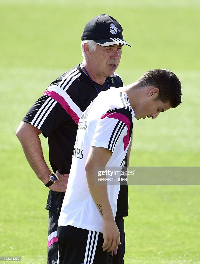 Real Madrid's Italian coach Carlo Ancelotti (L) and Real Madrid's Colombian forward James Rodriguez take part in a training session at the Valdebebas training ground in Madrid on August 5, 2014.