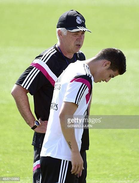 Real Madrid's Italian coach Carlo Ancelotti and Real Madrid's Colombian forward James Rodriguez take part in a training session at the Valdebebas...