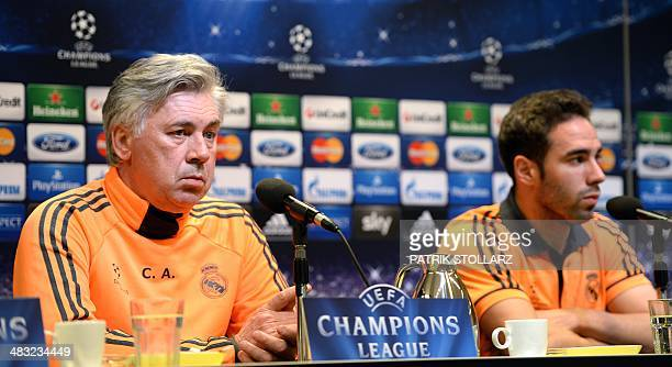Real Madrid's Italian coach Carlo Ancelotti and Real Madrid's defender Daniel Carvajal answer questions during a press conference on April 7 2014 in...