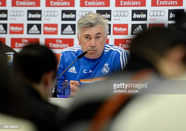 Real Madrid's Italian coach Carlo Ancelotti looks on during a press conference at Valdebebas training ground in Madrid on October 29 2013 on the eve...