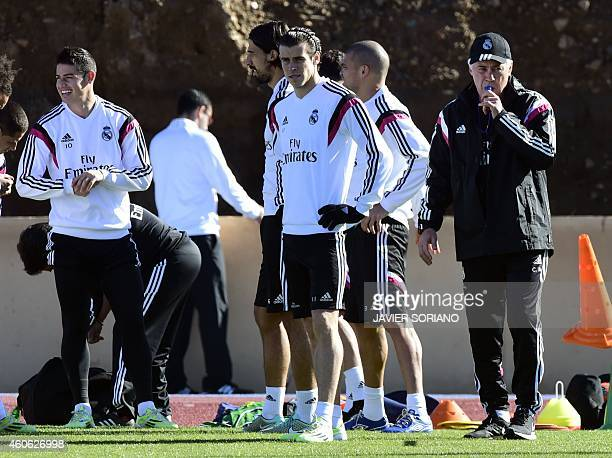 Real Madrid's Italian coach Carlo Ancelotti Welsh forward Gareth Bale and Colombian midfielder James Rodriguez take part in a training session on...