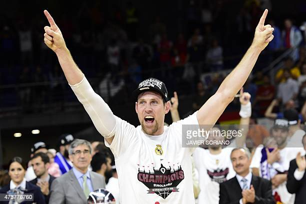 Real Madrid's Italian forward Andres Nocioni celebrates after winning the Euroleague Final Four basketball final against Olympiacos Pireus at the...