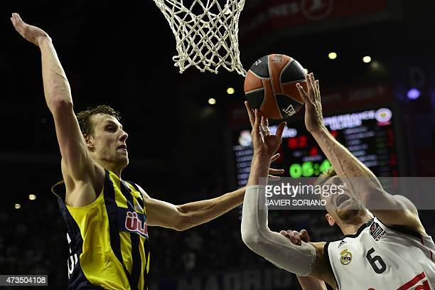 Real Madrid's Italian forward Andres Nocioni vies with Fenerbahce Ulker's Czech forward Jan Vesely during the Euroleague Final Four basketball...