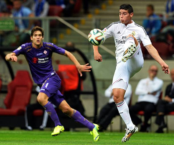Real Madrids Jamez Rodriguez R And FiorentinasMarcos Alonso Challange For A Ball