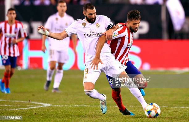 Real Madrid's Karim Benzema and Atletico Madrid's Felipe battle for the ball during the 2019 International Champions Cup football match between Real...