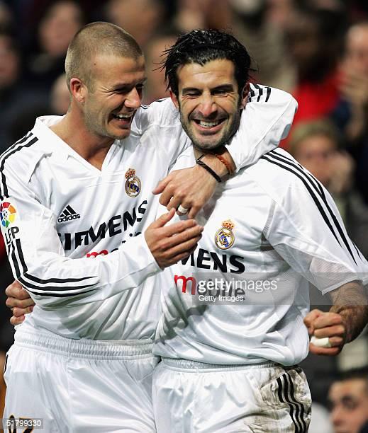 Real Madrid?s Luis Figo celebrates with teammate David Beckham after he scored a goal against Levante during their la Liga match at the Bernabeu,...
