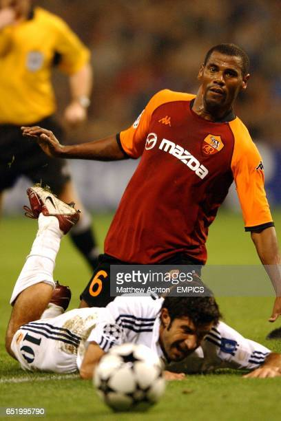 Real Madrid's Luis Figo goes down following a challenge from AS Roma's Aldair
