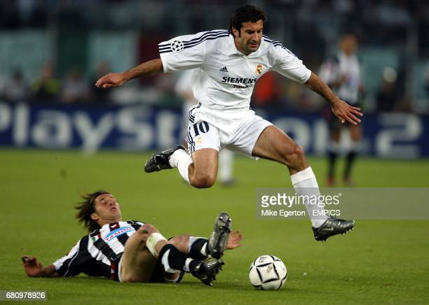 Real Madrid's Luis Figo jumps the challenge from Juventus' Alessio Tacchinardi
