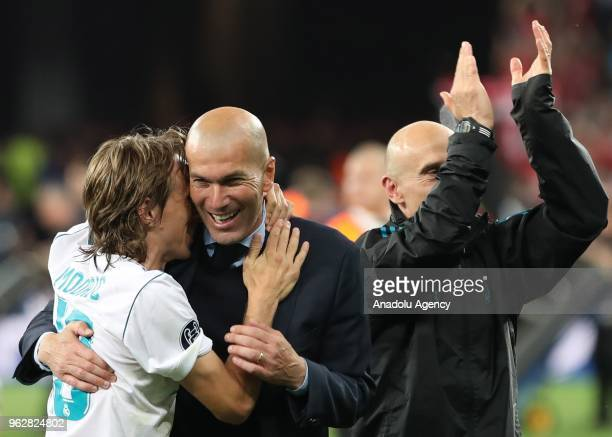 Real Madrid's Luka Modric and head coach Zinedine Zidane celebrate the victory after the UEFA Champions League final football match between Real...