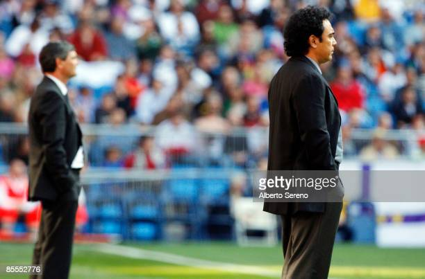 Real Madrid's manager Juande Ramos and Almeria's manager Hugo Sanchez look on during the Primera Liga match between Real Madrid and UD Almeria at the...