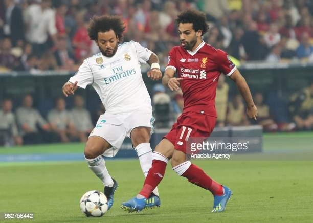 Real Madrid's Marcelo in action against Liverpool's Mohamed Salah during the UEFA Champions League final football match between Real Madrid and...