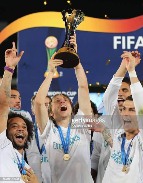 Real Madrid's Marcelo Luka Modric and Cristiano Ronaldo celebrate with the FIFA Club World Cup trophy following their victory in the final football...