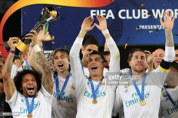 Real Madrid's Marcelo Luka Modric Cristiano Ronaldo and Sergio Ramos celebrate with the FIFA Club World Cup trophy following their victory in the...