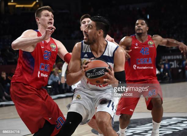 Real Madrid's Mexican center Gustavo Ayon vies with CSKA Moscow's Russian forward Andrey Vorontsevic and US center Kyle Hines during the third place...