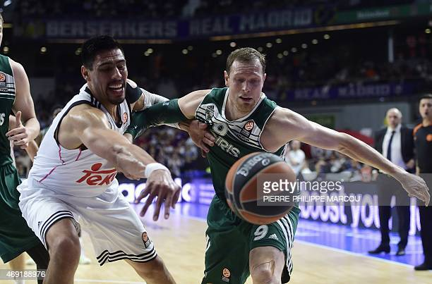 Real Madrid's Mexican center Gustavo Ayon vies with Zalgiris Kaunas' forward Darius Songaila during the Euroleague group E Top 16 round 14 basketball...