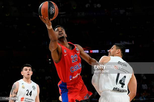 Real Madrid's Mexican centre Gustavo Ayon and Real Madrid's Argentinian forward Gabriel Deck challenge CSKA Moscow's US guard Cory Higgins during the...