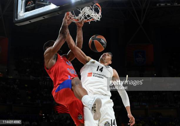 Real Madrid's Mexican centre Gustavo Ayon challenges CSKA Moscow's US centre Kyle Hines during the EuroLeague semifinal basketball match between CSKA...