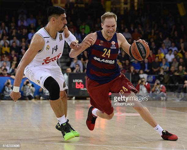 Real Madrid's Mexican centre Gustavo Ayon vies with Barcelona's guard Brad Oleson during the Euroleague top 16 group F basketball match FC Barcelona...