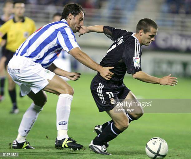 Real Madrids Michael Owen escapes from Leganes defender Ivan Albarran during a Kings Cup soccer match at Leganes Butarque stadium on October 26 2004...