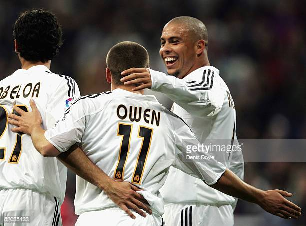 Real Madrid's Michael Owen is congratulated by Ronaldo and Arbeloa after scoring a goal during a Copa del Rey 3rd round 2nd leg match between Real...