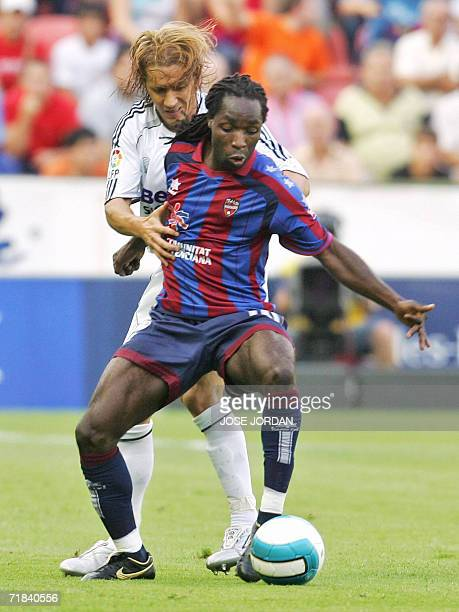 Real Madrids Michael Salgado vies for the ball with Levantes Mustapha Riga from Ghana during their Spanish league football match at Ciudad de...