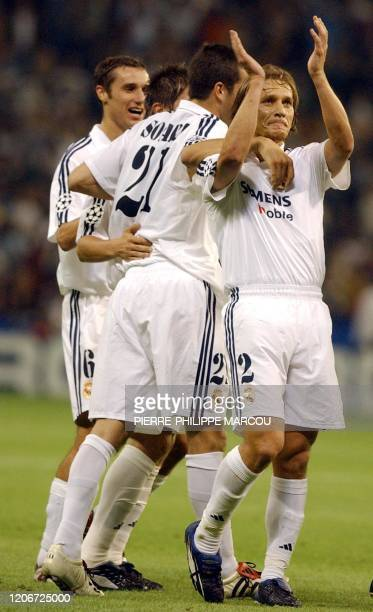 Real Madrid's Michel Salgado celebrates his goal against Genk with teammates during the Champions League match between Real Madrid and RC Genk In...