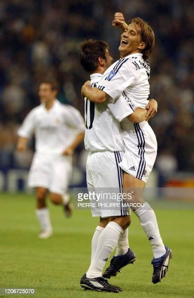 Real Madrid's Michel Salgado celebrates his goal against Genk with Celades during the Champions League match between Real Madrid and RC Genk In...