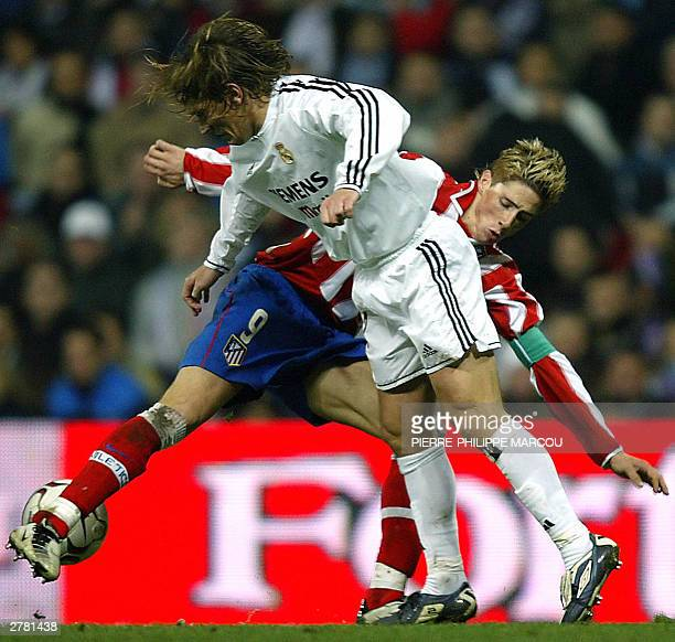 Real Madrid's Michel Salgado fights for the ball with Atletico de Madrid's Fernando Torres during a Premier League match beetwen Real Madrid and...