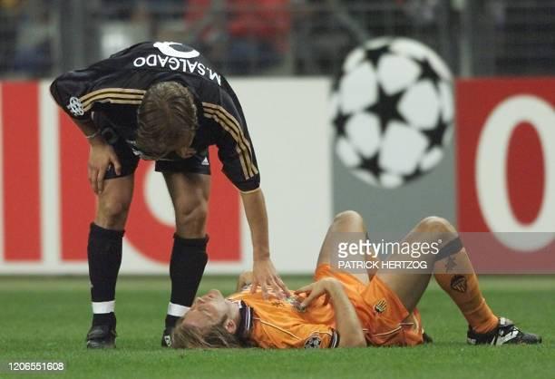 Real Madrid's Michel Salgado offers his comfort to Spanish midfielder of Valencia Gaizka Mendieta after Valencia lost the Champion's League final at...