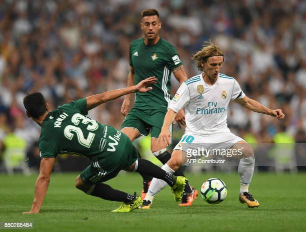 Real Madrid's midfielder from Croatia Luka Modric vies with Real Betis' defender from Algeria Aissa Mandi during the Spanish league football match...