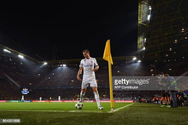 Real Madrid's midfielder from Germany Toni Kroos prepares to take a corner during the UEFA Champions League Group H football match BVB Borussia...