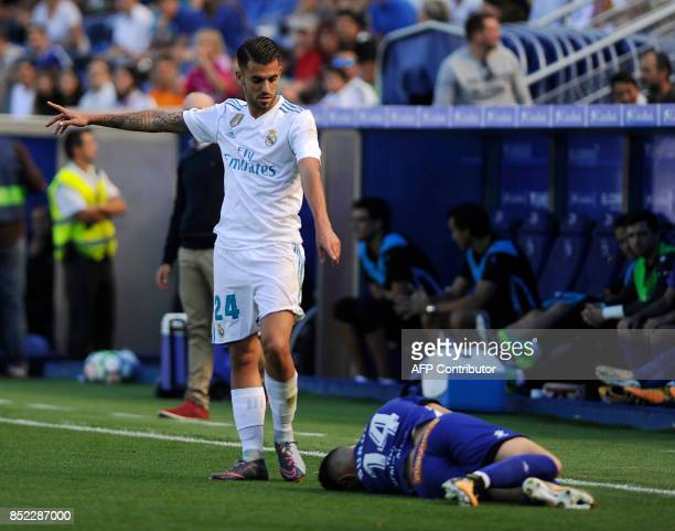 Real Madrid's midfielder from Spain Daniel Ceballos gestures as Alaves' forward from Spain Jorge Franco Burgui lies on the field during the Spanish...