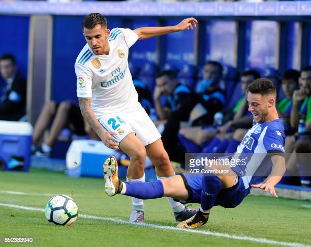 Real Madrid's midfielder from Spain Daniel Ceballos vies with Alaves' forward from Spain Jorge Franco Burgui during the Spanish league football match...