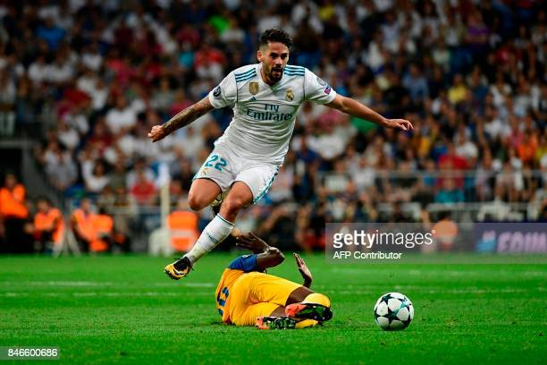 TOPSHOT Real Madrid's midfielder from Spain Isco jumps to avoid an APOEL's player during the UEFA Champions League football match Real Madrid CF vs...