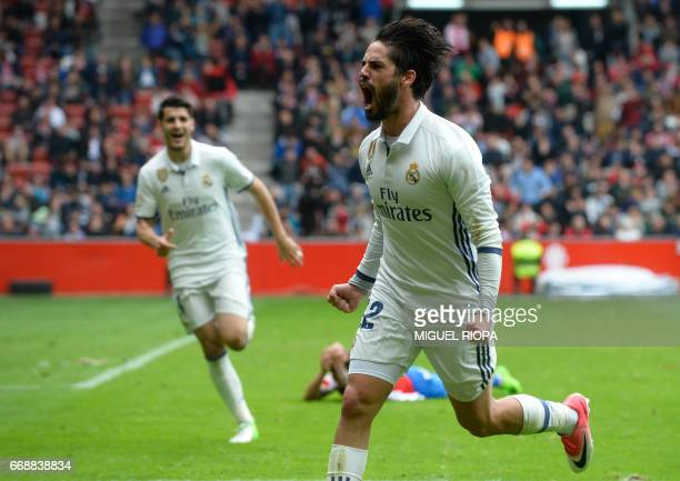 Real Madrid's midfielder Isco celebrates after scoring a goal during the Spanish league football match Real Sporting de Gijon vs Real Madrid CF at El...