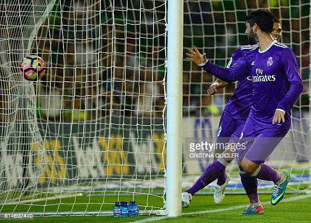 Real Madrid's midfielder Isco celebrates after scoring during the Spanish league football match Real Betis vs Real Madrid CF at the Benito Villamarin...