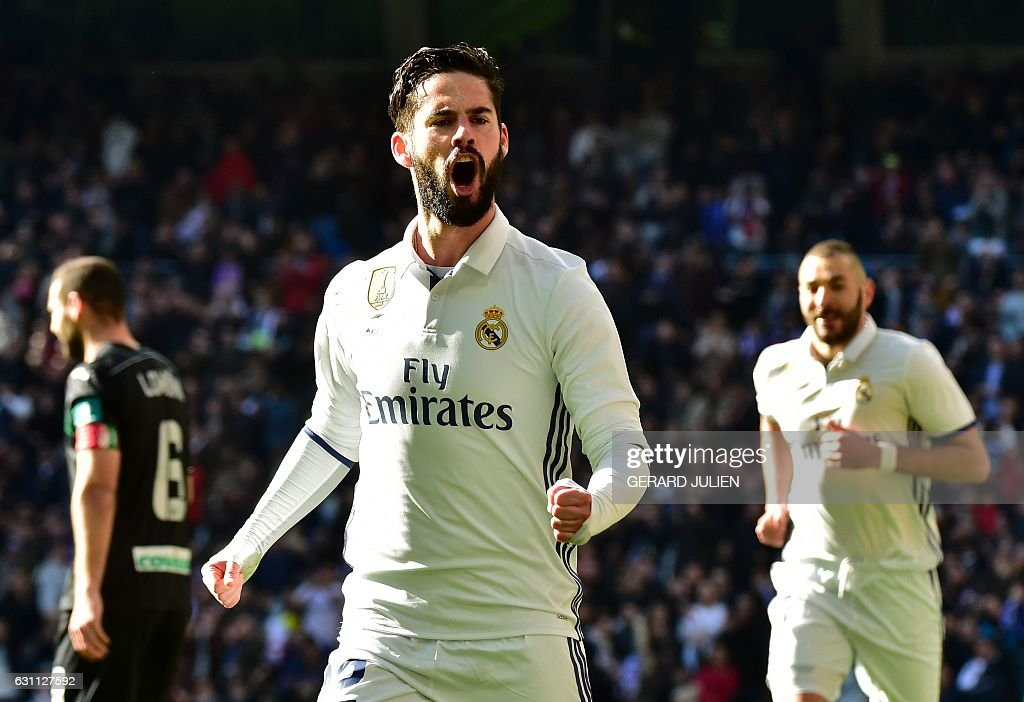 Real Madrid's midfielder Isco celebrates after scoring during the Spanish league football match Real Madrid CF vs Granada FC at the Santiago Bernabeu stadium in Madrid on January 7, 2017. / AFP / GERARD