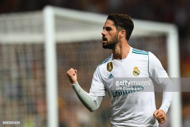 Real Madrid's midfielder Isco celebrates his second goal during the Spanish league football match Real Madrid CF vs RCD Espanyol at the Santiago...