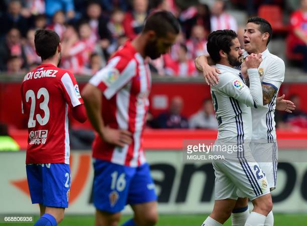 Real Madrid's midfielder Isco celebrates with teammate Colombian midfielder James Rodriguez after scoring a goal during the Spanish league football...
