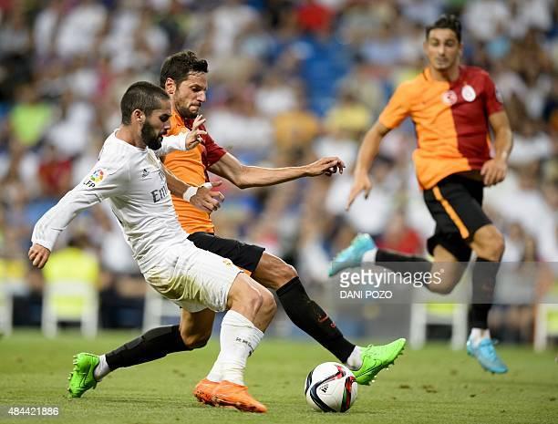 Real Madrid's midfielder Isco kicks the ball during the Trofeo Santiago Bernabeu football match Real Madrid vs Galatasaray at the Santiago Bernabeu...