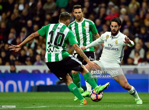Real Madrid's midfielder Isco vies with Betis' forward Dani Ceballos during the Spanish league footbal match Real Madrid CF vs Real Betis at the...