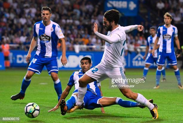 Real Madrid's midfielder Isco vies with Deportivo La Coruna's defender Juanfran Moreno during the Spanish league footbal match RC Deportivo de la...